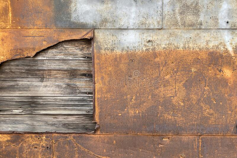 Rusted steel metal wall exposed rotten wood board royalty free stock images