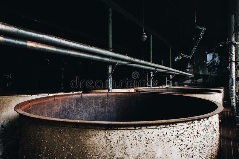 Rusted Steel Tanks - Abandoned Old Taylor Bourbon Distillery - Kentucky. Rusted steel tanks lie inside the abandoned Old Taylor Bourbon Distillery near Frankfort royalty free stock images