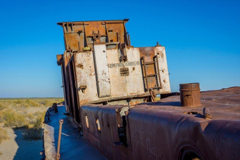 Rusted vessel in the ship cemetery, Uzbekistan. Old ships in the desert `ship cemetery` the consequence of Aral sea disaster, Muynak, Uzbekistan stock photo