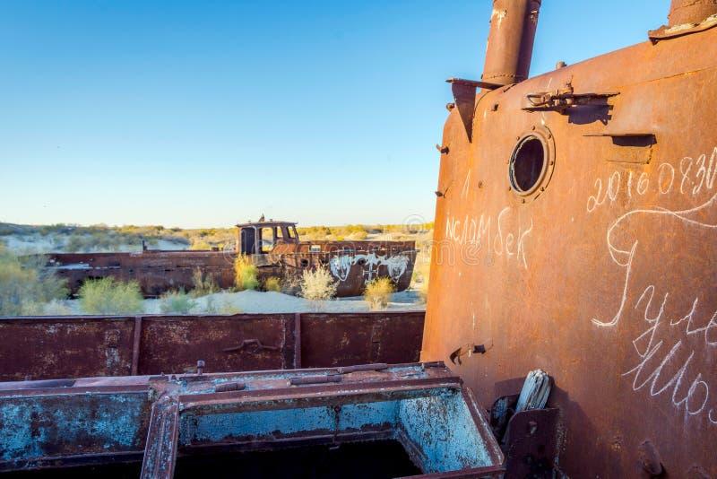 Rusted vessel in the ship cemetery, Uzbekistan. Old ships in the desert `ship cemetery` the consequence of Aral sea disaster, Muynak, Uzbekistan stock photos
