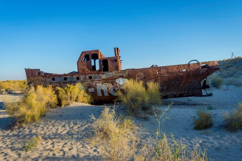 Rusted vessel in the ship cemetery, Uzbekistan. Old ships in the desert `ship cemetery` the consequence of Aral sea disaster, Muynak, Uzbekistan royalty free stock photos