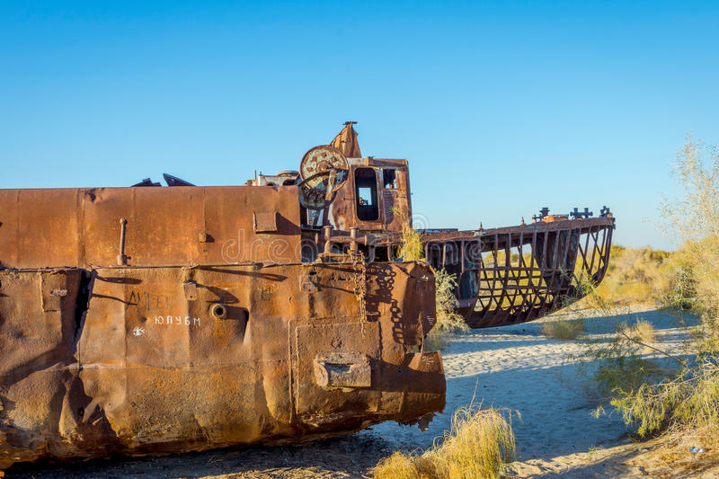 Rusted vessel in the ship cemetery, Uzbekistan. Old ships in the desert `ship cemetery` the consequence of Aral sea disaster, Muynak, Uzbekistan royalty free stock images