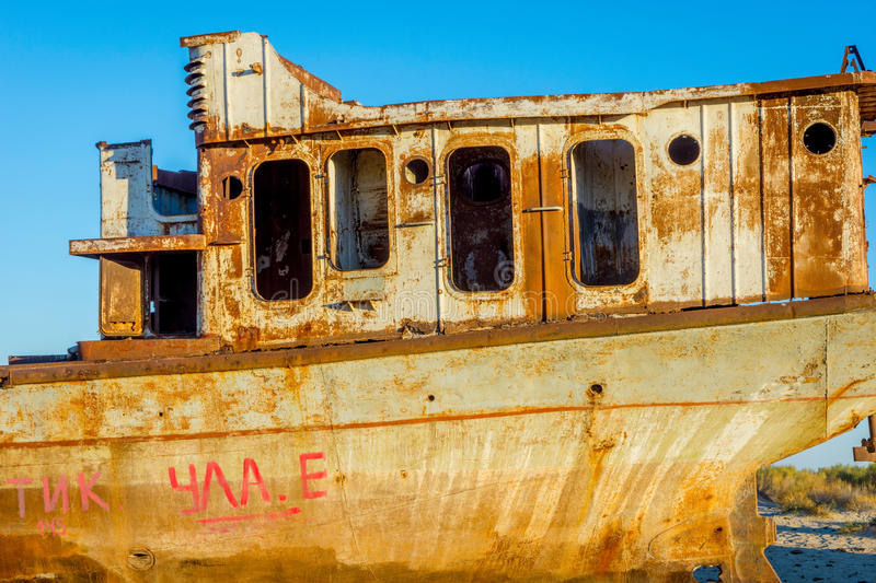 Rusted vessel in the ship cemetery, Uzbekistan. Old ships in the desert `ship cemetery` the consequence of Aral sea disaster, Muynak, Uzbekistan stock images