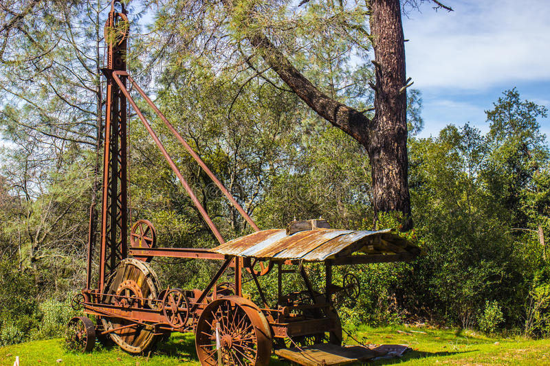 Rusted Vintage Drilling Tower & Equipment. Vintage Rusted Drilling Machine & Tower royalty free stock image
