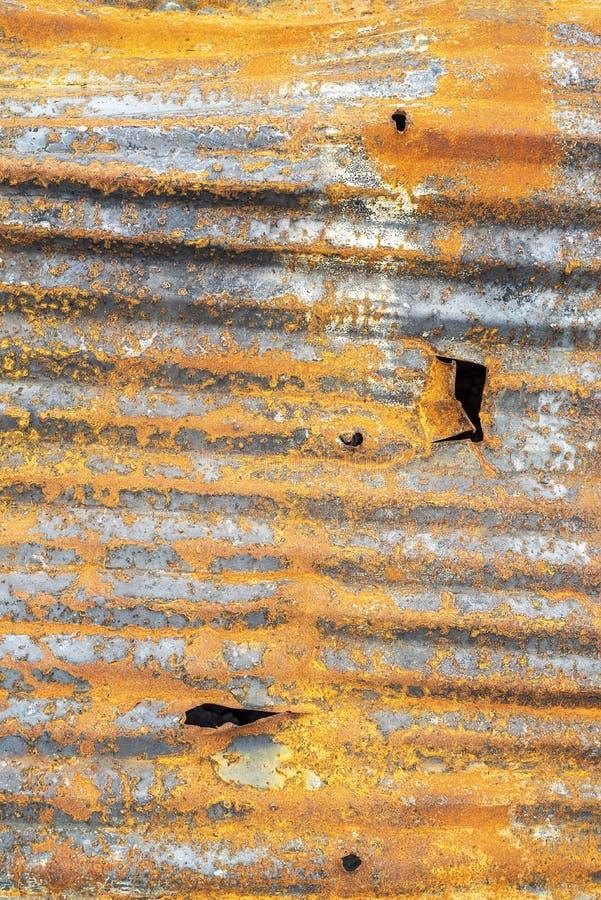 Rustgeflochtener, orangefarbener und gelber Hintergrund aus Wellpappe lizenzfreie stockfotografie