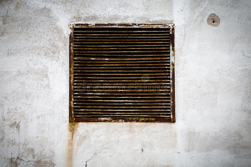 Rustic air vent. Window on a grungy wall royalty free stock photos