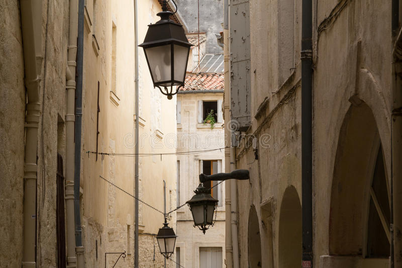 Rustic Alley with Old Limestone Houses and Lanterns, Montpelier, France. Europe stock photo
