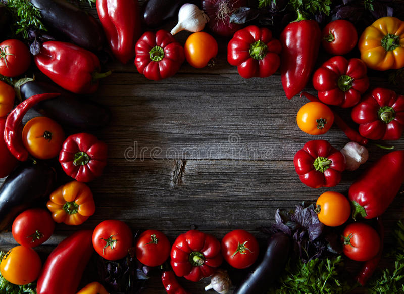 Rustic background with farm assortment vegetables, top view. Healthy food or vegetarian cooking concept. stock images