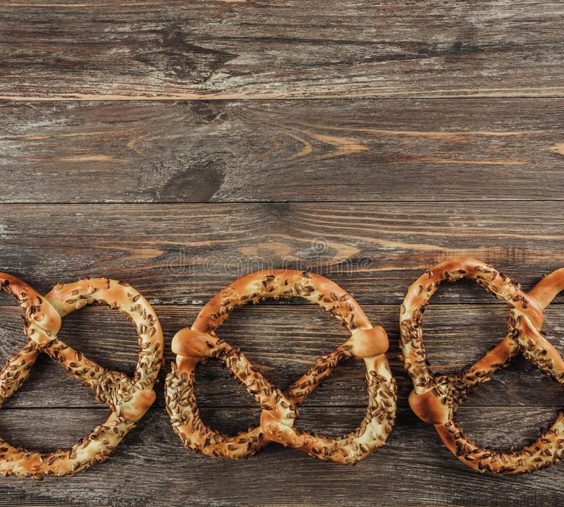 Rustic background for Oktoberfest or Bavarian specialties, pretzels on wooden table. Top view, copy space royalty free stock photos