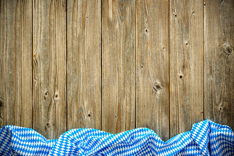 Rustic background for Oktoberfest. With bavarian white and blue fabric royalty free stock photos