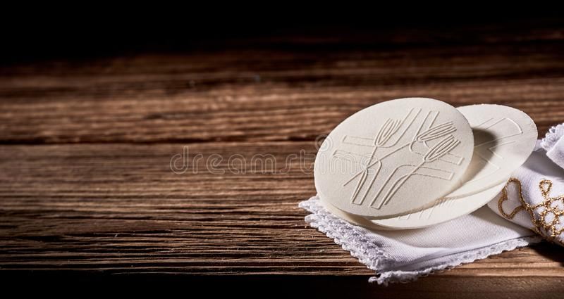 Rustic banner with Hosties or Sacramental Bread. Symbolising the body of Christ for Holy Communion with copy space royalty free stock photos