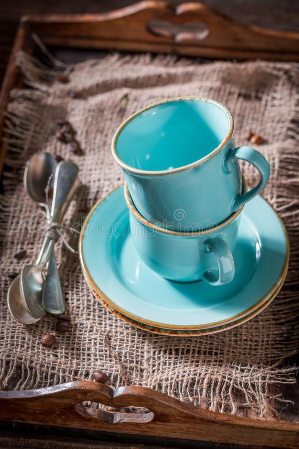 Rustic blue coffee cup on old burlap napkin. On old wooden table stock photos