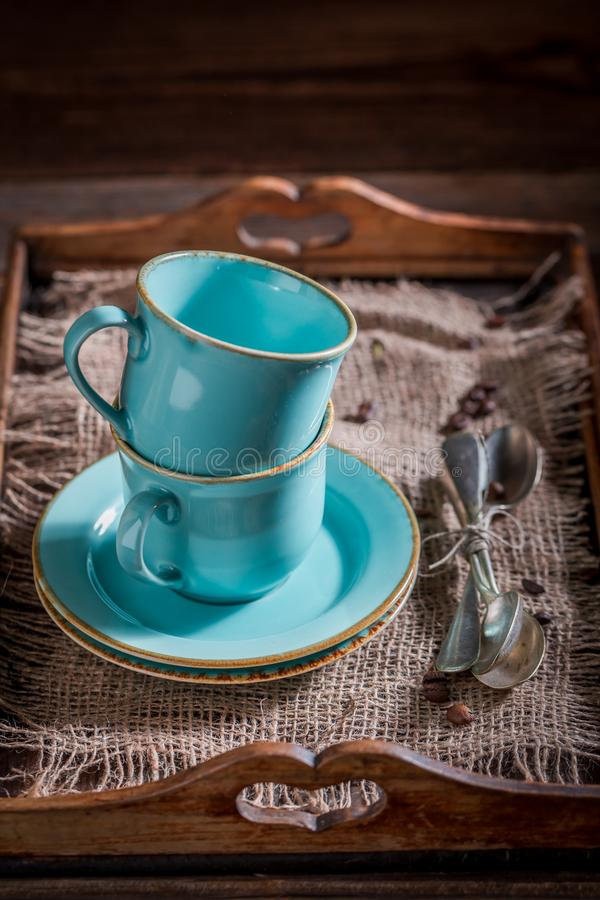 Rustic blue coffee cup. On old wooden tray stock image