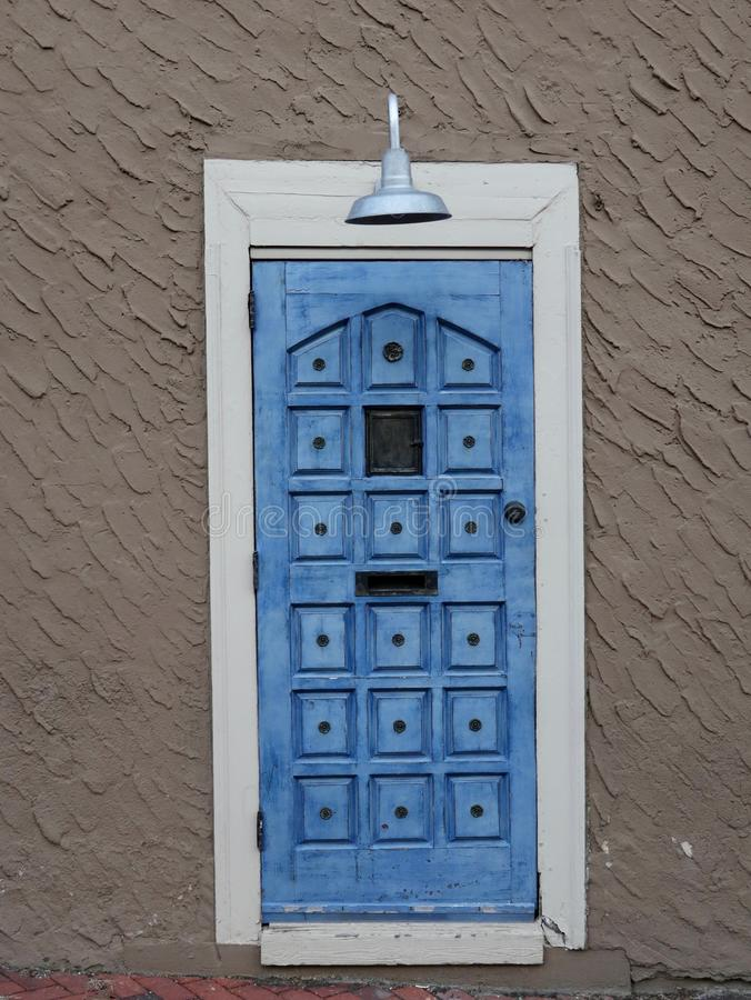 Rustic Blue Door With Overhead Lamp royalty free stock photos