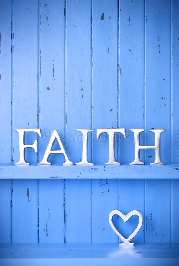Faith Love Christian Background. A rustic blue painted wood background with the word faith spelled out in metal letters and a love heart stock images