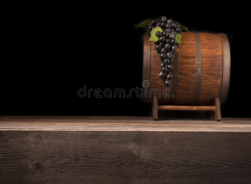 Rustic blurred wooden barrel on a night background stock images