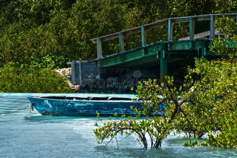 Rustic boat in a quiet lagoon. stock photography