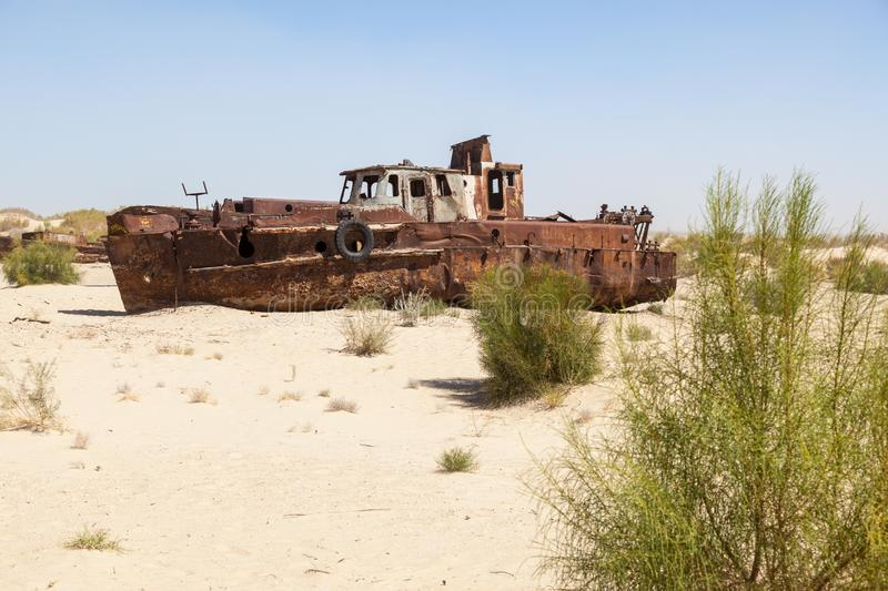 Rustic boats on a ship graveyards on a desert around Moynaq, Muynak or Moynoq - Aral sea or Aral lake - Uzbekistan in Central Asia. Rustic boats on a ship royalty free stock images