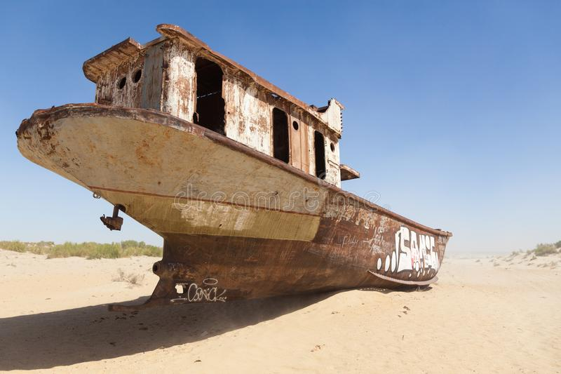 Rustic boats on a ship graveyards on a desert around Moynaq, Muynak or Moynoq - Aral sea or Aral lake - Uzbekistan in Central Asia. Rustic boats on a ship royalty free stock photography