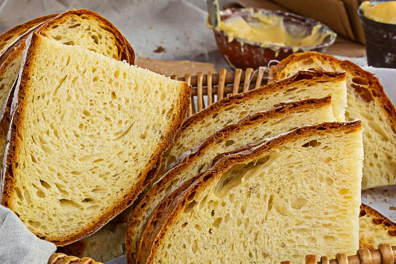 Rustic bread chopped symmetrical slices many in a basket fresh delicious with baked crust backdrop bakery royalty free stock photo