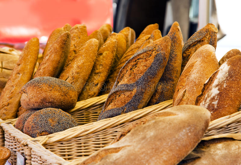 Rustic bread at french market stand royalty free stock images