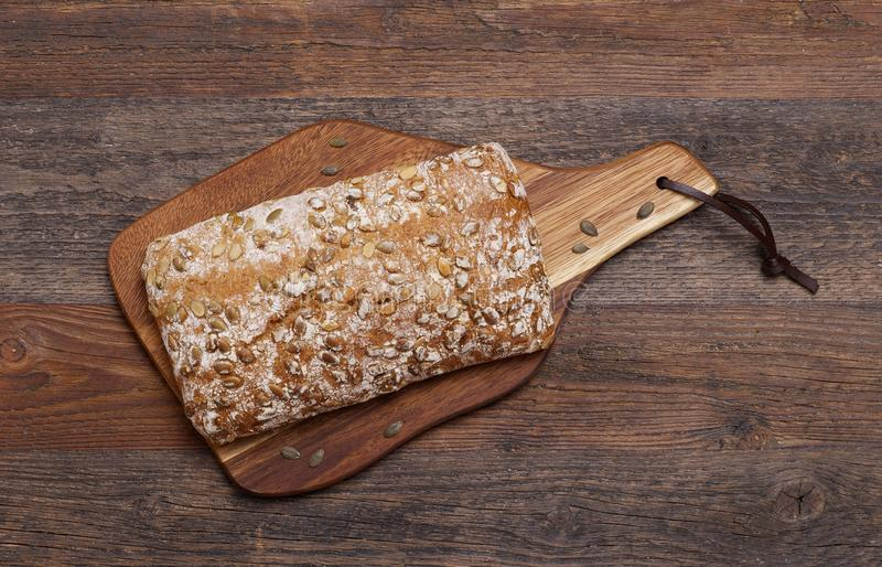 Rustic bread with seeds stock photo