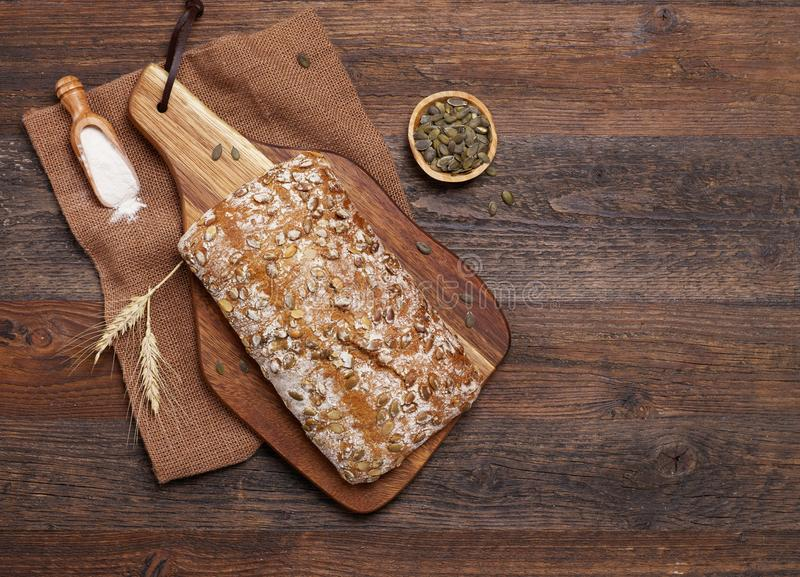 Rustic bread with seeds stock images