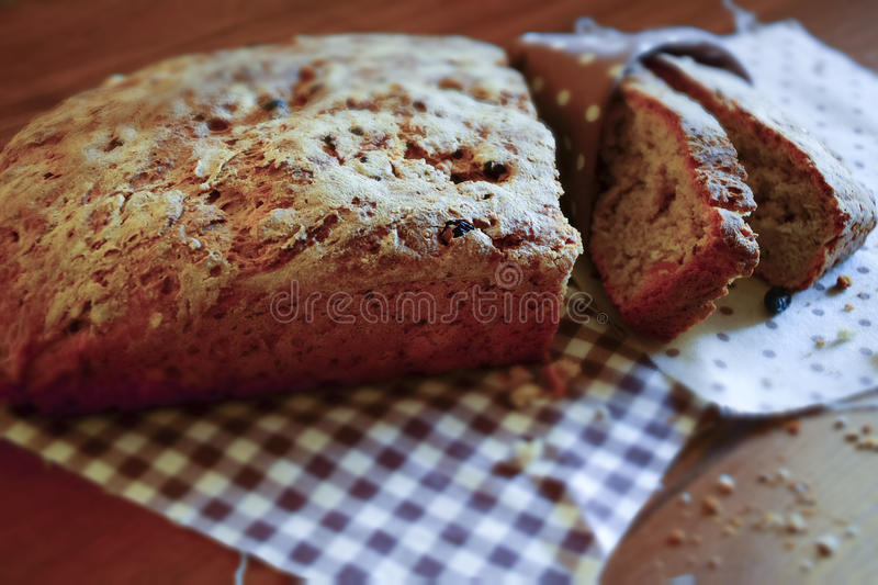 Rustic bread sliced pieces. Rustic rye bread sliced slices with raisins, prepared without the use of yeast, baking powder and soda stock photos