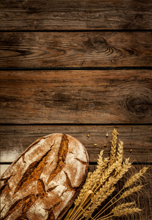 Rustic Bread And Wheat On Vintage Wood Table Stock Photo