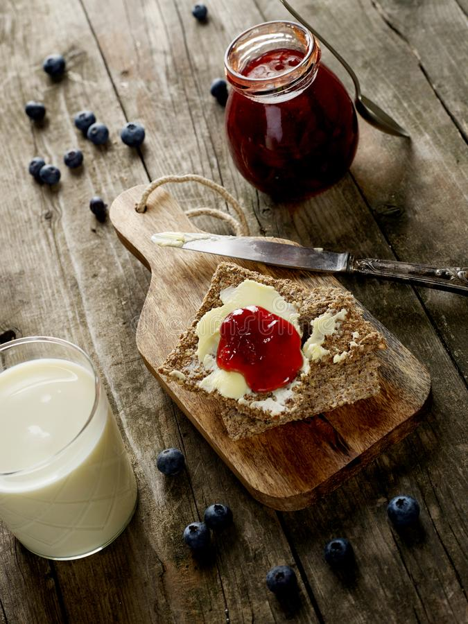 Rustic breakfast on dark background stock photography