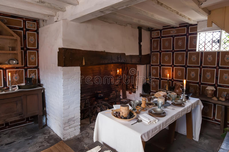 Rustic breakfast. Interior of an old country cottage with fireplace and rustic table set for a breakfast stock photography