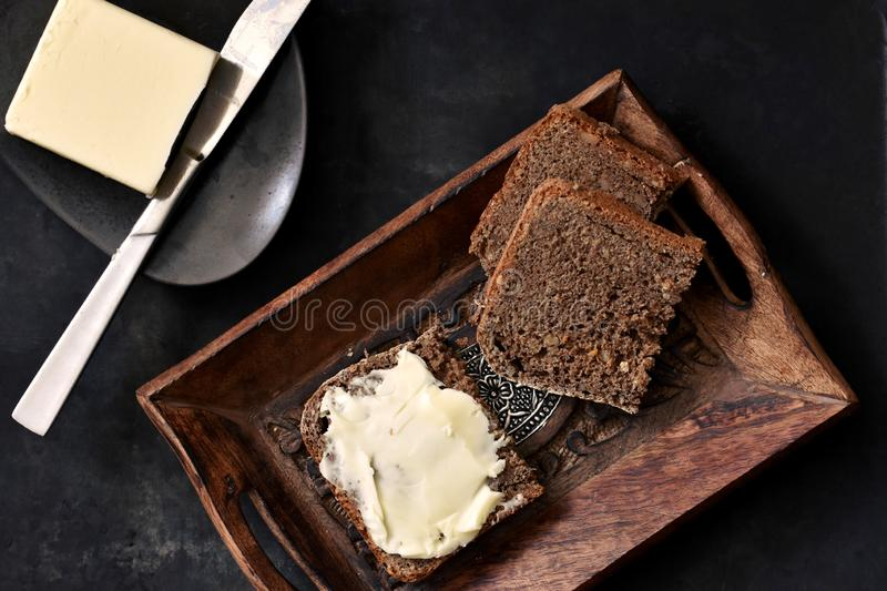Rustic breakfast, whole grains bread and butter stock images