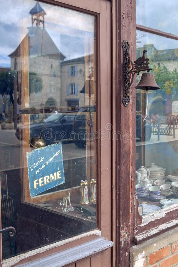 A rustic bric a brac shop stays closed on a Monday afternoon in picturesque Tournon d`Agenais royalty free stock photography