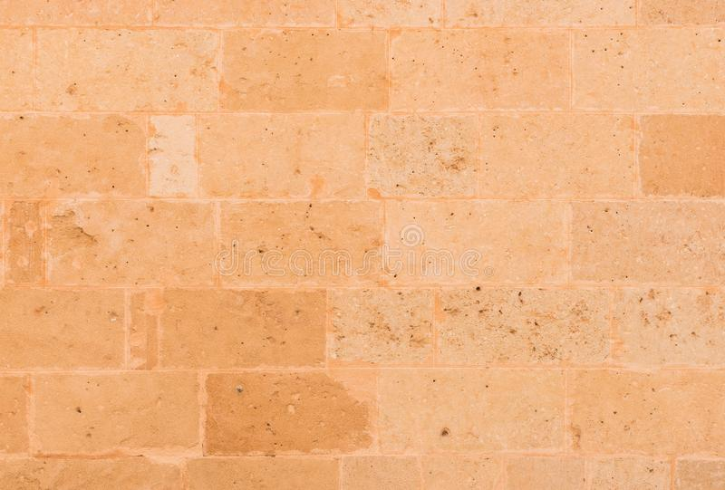 Rustic brown block shaped stone wall background royalty free stock photos
