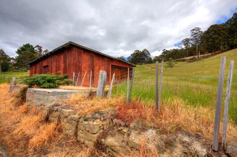 Rustic cabin. An historic, rustic cabin set on pretty Tasmanian farmland royalty free stock photo