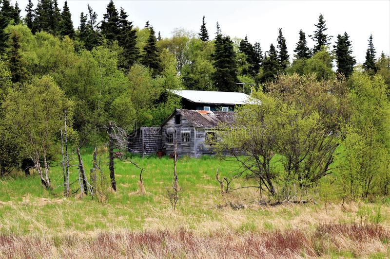 Rustic Cabin with a modern home in the background stock images