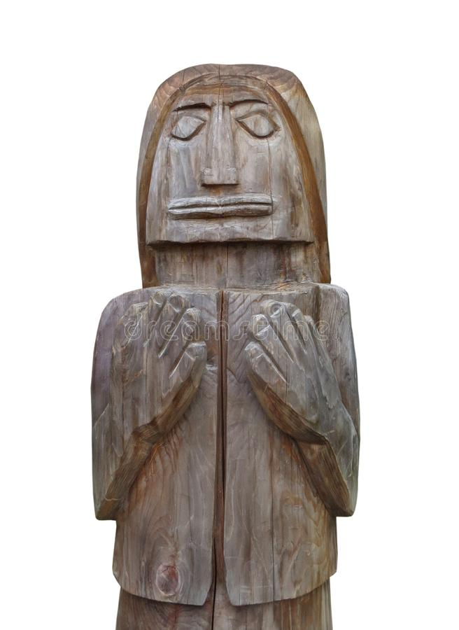Rustic carved wooden man isolated. royalty free stock photography