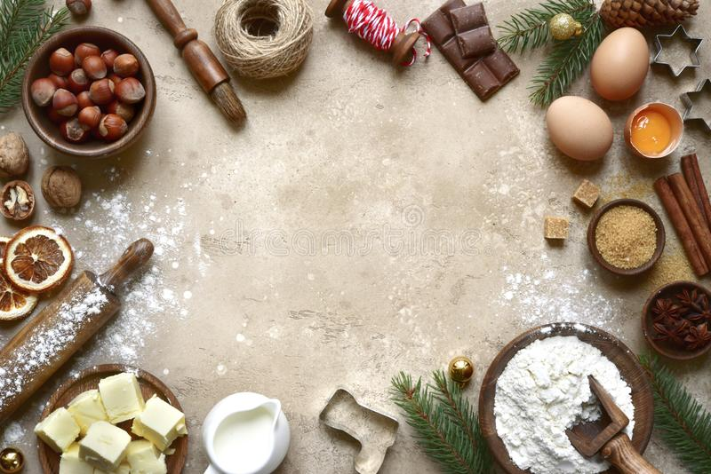 Rustic christmas baking background with ingredients for making c. Ookies or cake over beige slate,stone or concrete background.Top view with space for text royalty free stock photos