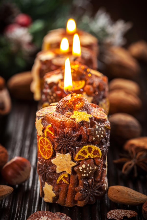 Rustic Christmas candles with spices and nuts royalty free stock image