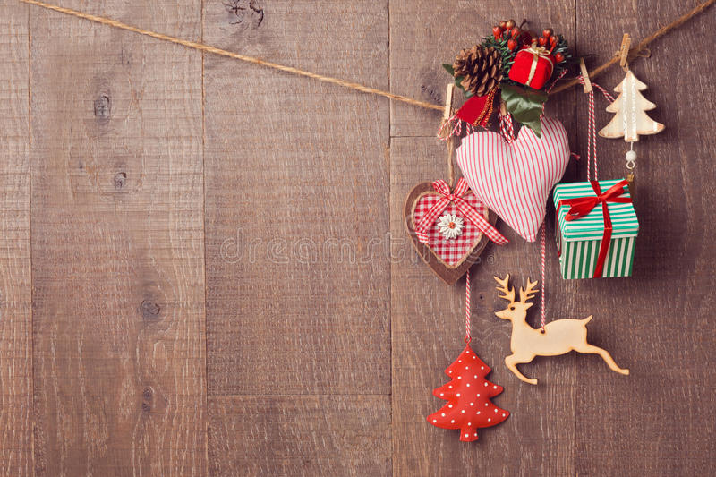 Download Rustic Christmas Decorations Hanging Over Wooden Background With Copy Space Stock Photo - Image: 60732888