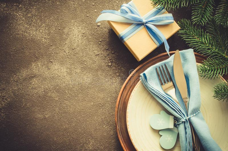 Rustic Christmas table setting. Winter background for writing the Christmas or New Year Menu royalty free stock photo
