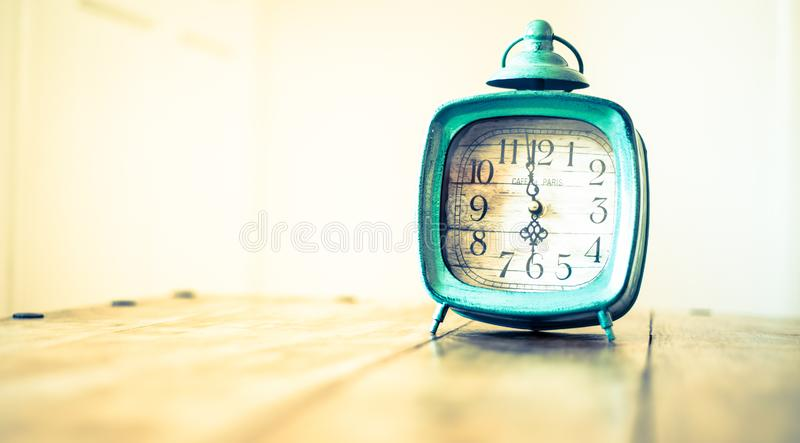 Rustic clock - vintage old fashioned clock royalty free stock photos