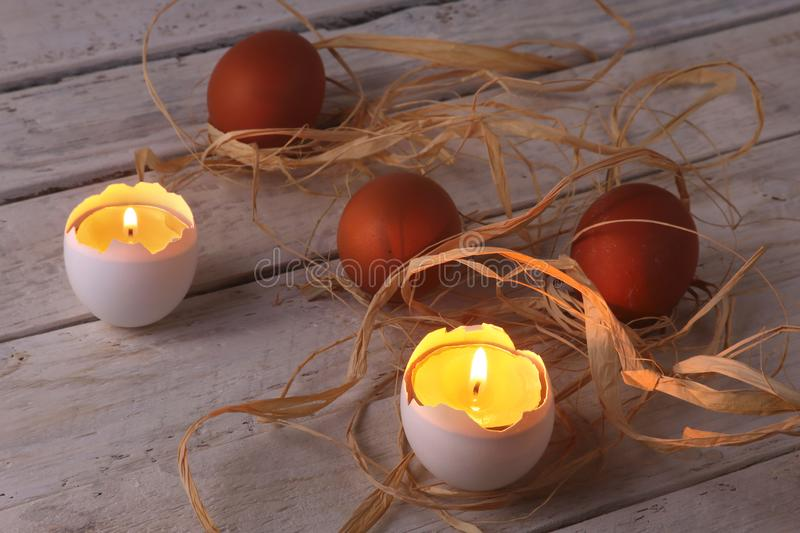 Rustic composition with candles and eggs. Happy easter. Selective focus. stock photos