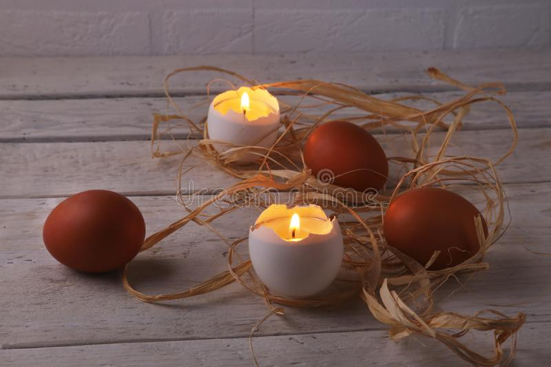 Rustic composition with candles and eggs. Happy easter. Selective focus. royalty free stock images