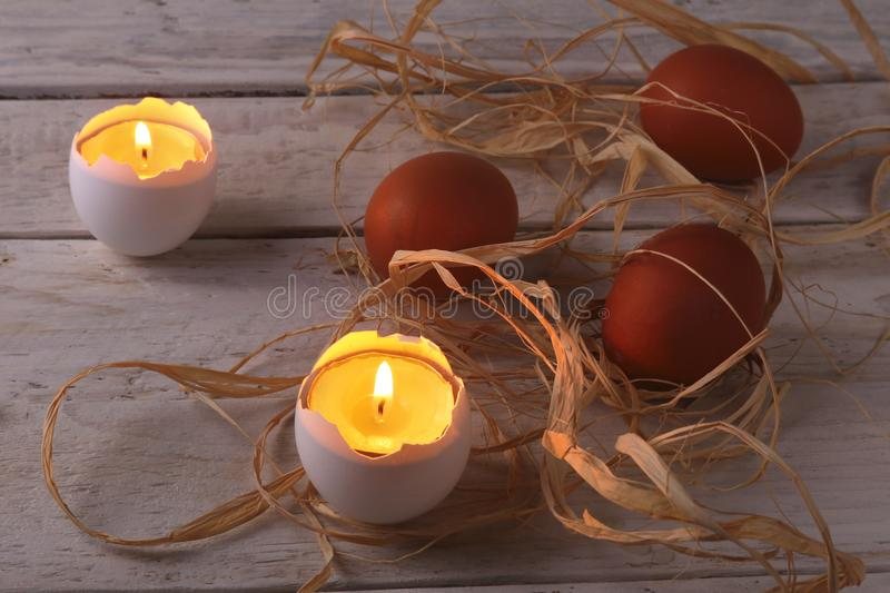 Rustic composition with candles and eggs. Happy easter. Selective focus. royalty free stock image