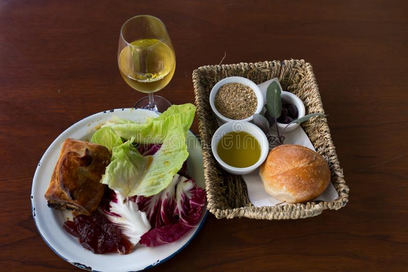 Rustic Dine and Wine at Barossa Valley. A combination of salad, jam, pie, bread, and white wine in a rustic restaurant at Barossa Valley in South Australia royalty free stock photography