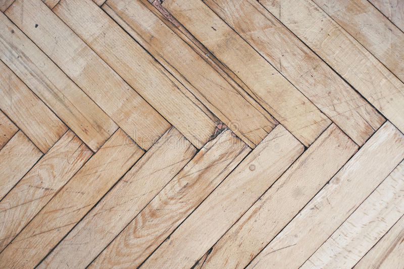 Close Top View On Rich Texture Of Old Brushed And Distressed Wooden Parquet Floor Made From Many Racks In Herringbone Pattern Abstract Background Image