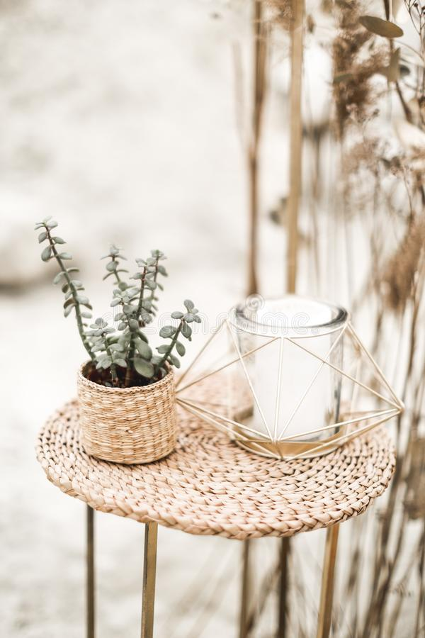 Rustic, eco and boho wedding in the desert canyon with decor. Candles, succulents, golden stands, decorations in rustic stock photography