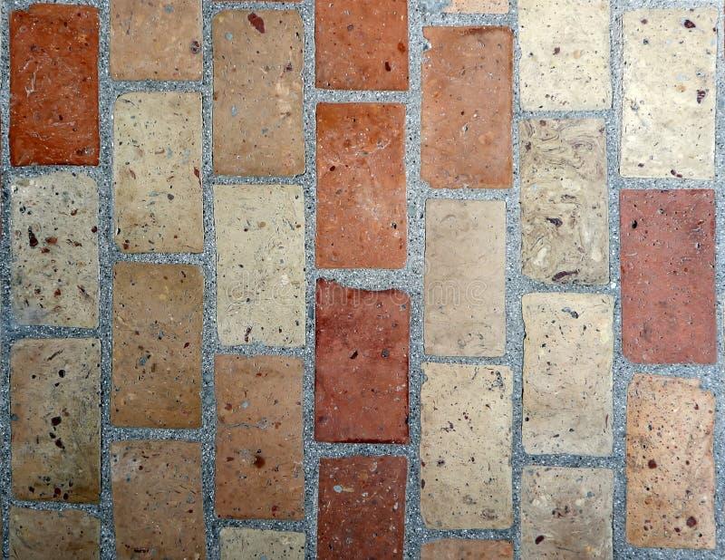 Rustic floor texture made of mixed terracotta bricks. Exterior tiles for outdoor patio. Or terraces stock photos