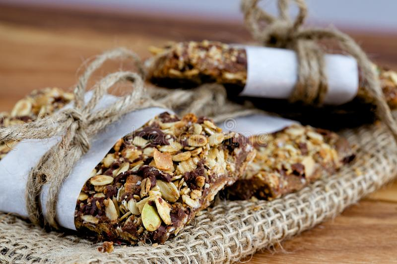 Rustic Granola Bars Stacked and on Burlap with Twine royalty free stock image